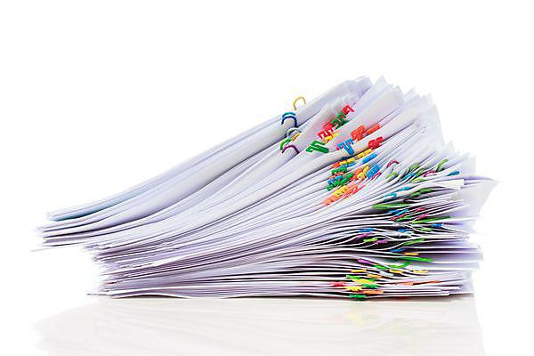 <p>Stack of documents; literature review</p>