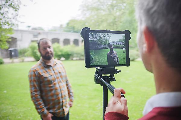 <p>Recording a video using an iPad in the park.<br></p>