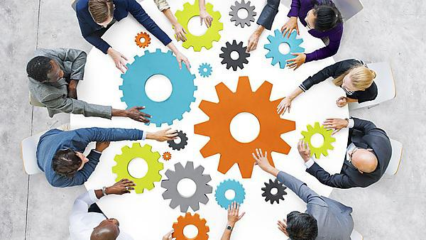 <p>Business people with gears and teamwork concept</p>