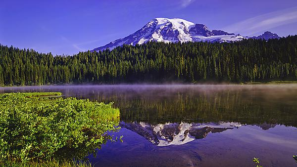 <p>  Spring morning mist rises of the still lake waters in Mount Rainier NP, Washington. Image courtesy of Getty Images. <br></p>