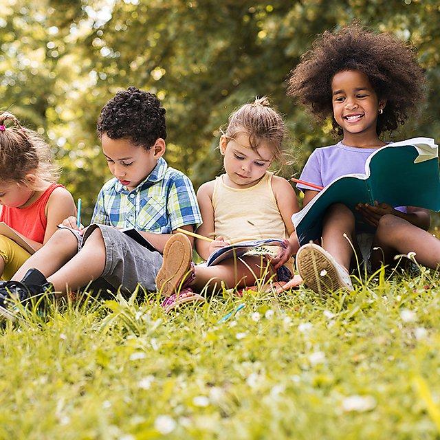 <p>Children writing in the park - PIoE&nbsp;</p>