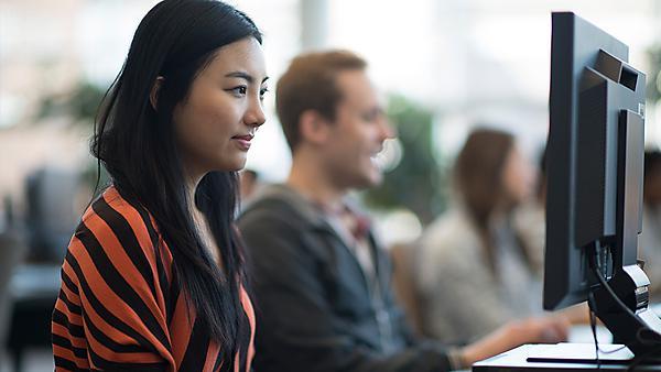 <p>Students at computers</p>