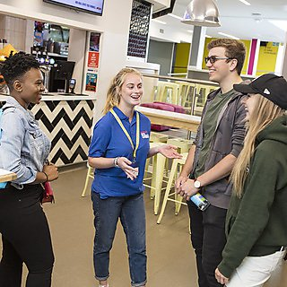 <p>students in the Students Union on an open day</p>
