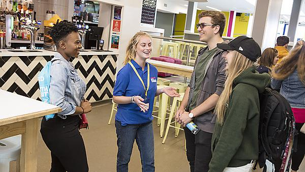 <p>Students in the Students' Union on an open day</p>