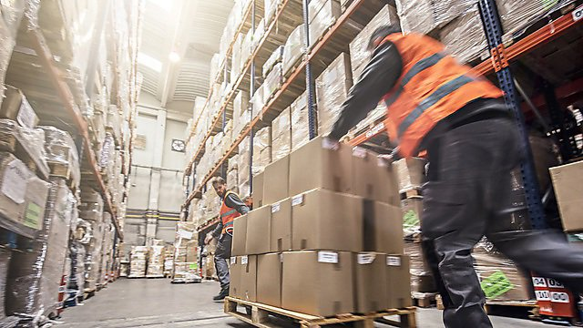 <p>  </p><div>Motion blur of two men moving boxes in a warehouse</div>  <br><p></p>