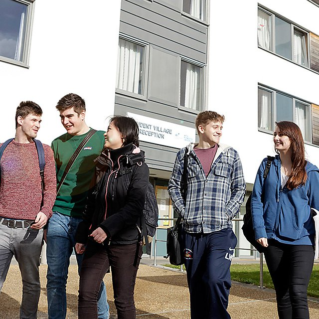 <p>Students outside Drake Hall square</p>