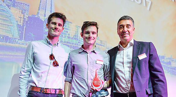 <p>Ed and Paul Bird accepting their award from Santander UK CEO Nathan Bostock</p>