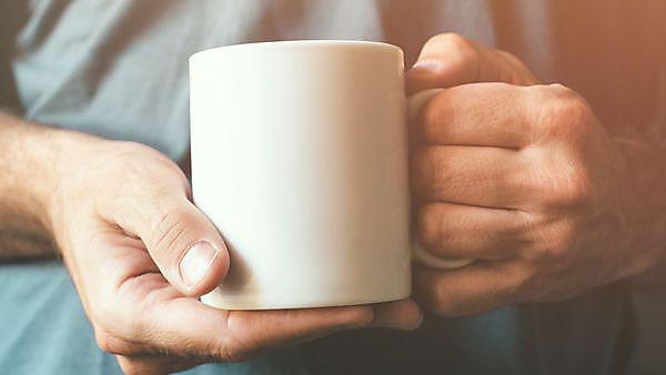 <p>White coffee cup in male hands, credit: stevanovicigor, courtesy of Getty Images<br></p>