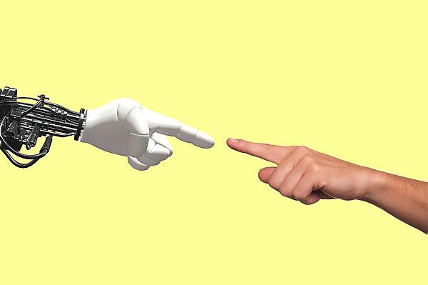 <p>Robot arm points to human arm</p>