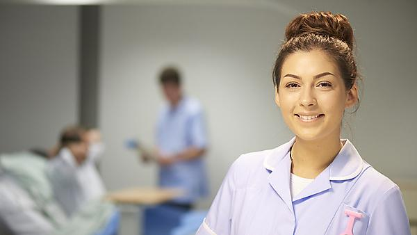 <p>young female nurse on a ward. Image courtesy of Getty Images.</p>