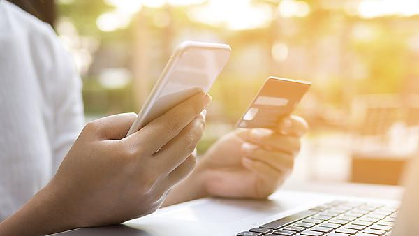 <p>Business woman using smart phone, credit card and laptop for online shopping, online payment, internet banking. Image courtesy of Getty Images.<br></p> Usage: Image courtesy of Getty Images.