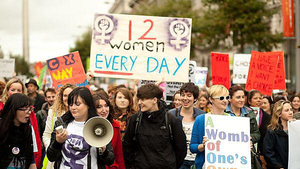 <p>Group of women holding informational posters regarding abortion, courtesy of Getty<br></p>
