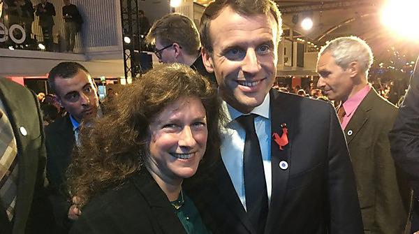 <p>University academic Professor Camille Parmesan with the President of France Emmanuel Macron</p>