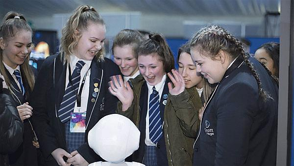 <p> Science and Technology Showcase 2018. School girls looking at a robot<br></p>