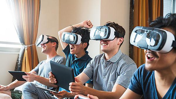 <p>Group of friends playing games using virtual reality headsets<br></p>