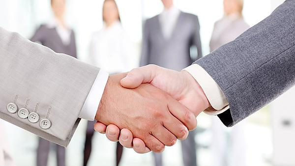 <p>Close up of business people shaking hands over a deal<br></p>