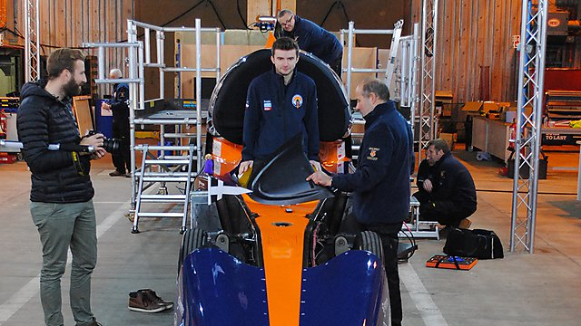 <p>Jack Williams standing in the Bloodhound Supersonic Car</p>