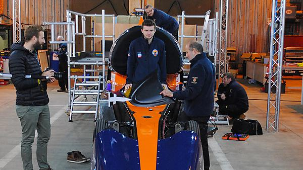 Jack Williams standing in the Bloodhound Supersonic Car