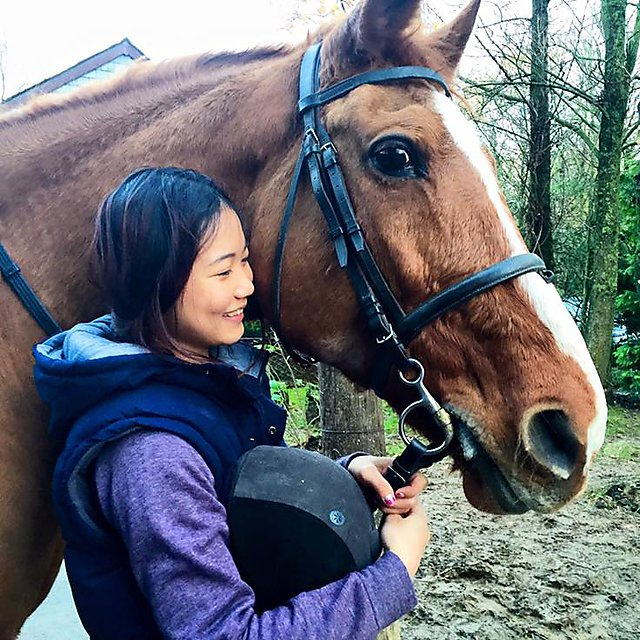 <p>Angelia Ong with a horse</p>