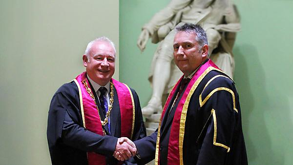 <p>Ian Mills, left, with Mick Horton, outgoing Dean of the Faculty of General Dental Practice (UK)<br></p>