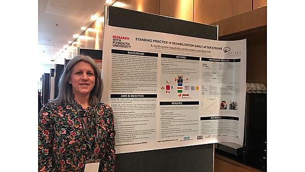 <p>Angie Logan with her poster presentation at the ACPIN Conference 2018</p>