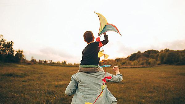 <p>Boy flying kite with Dad</p>