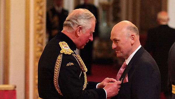 Professor Richard Thompson receiving his OBE from the Prince of Wales