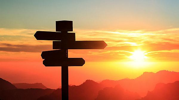<p>Getty signpost sunset</p>