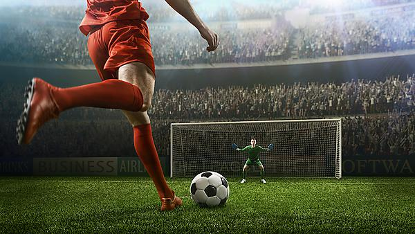 <p>A football player taking a penalty against a goalkeeper<br></p>