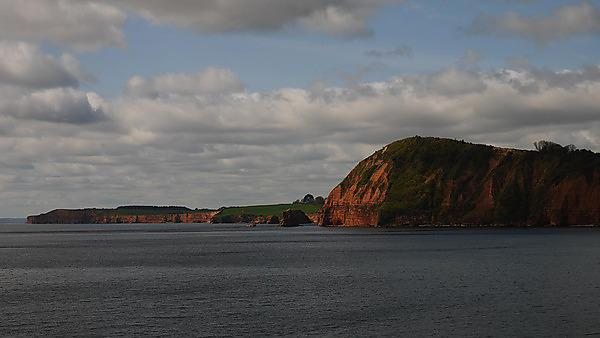 View of Triassic sandstone cliffs in Lyme Bay west of Sidmouth, Devon, England