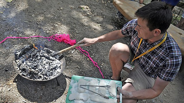 <p>The pizzas were finished off on an open fire pit for all to see. Delicious!</p>