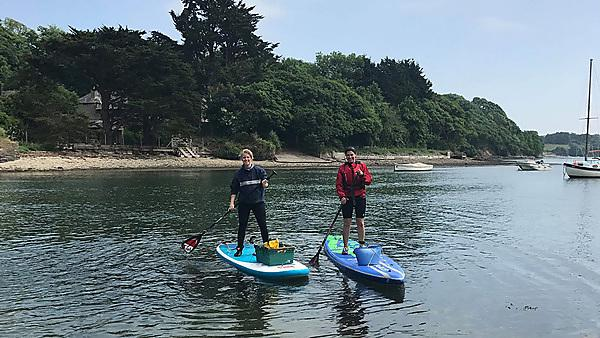 Imogen (left) taking part in the paddle pick