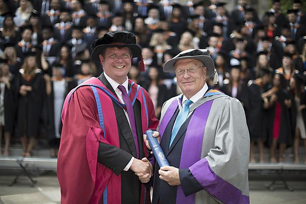<p>Chris Tredwin and Nairn Wilson honorary doctorate </p>