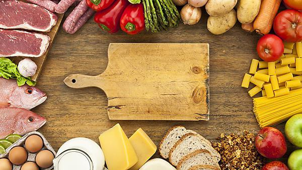 <p>Assorted food border on wood table shot from above<br></p>