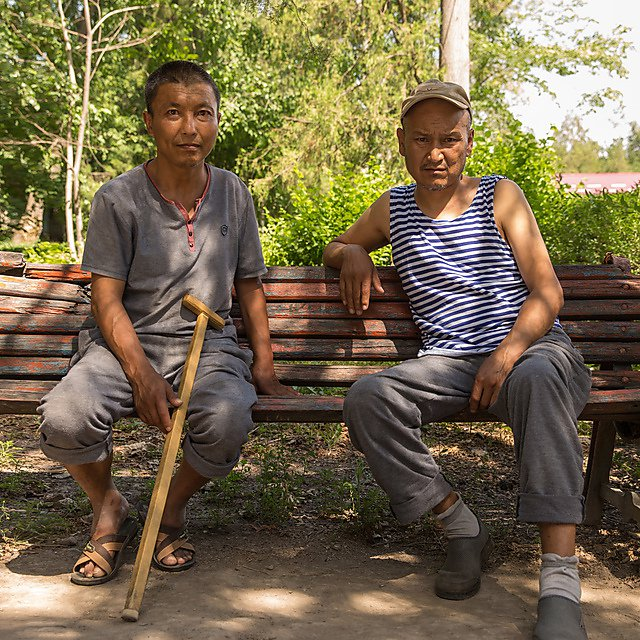<p>Tuberculosis patients resting on the broken bench outside Bishkek Tuberculosis sanatorium. Image: Carey Marks<br></p>
