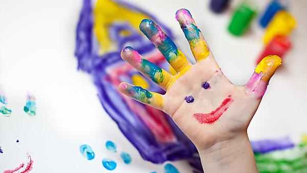 Little Children Hands doing Fingerpainting by nailiaschwarz, courtesy of Getty