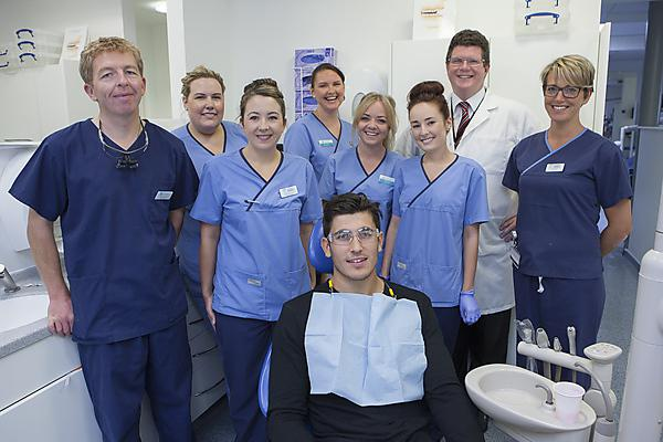 Elliot Clements-Hill, full back with Plymouth Albion RFC, and the dental team at Plymouth University Peninsula Schools of Medicine and Dentistry