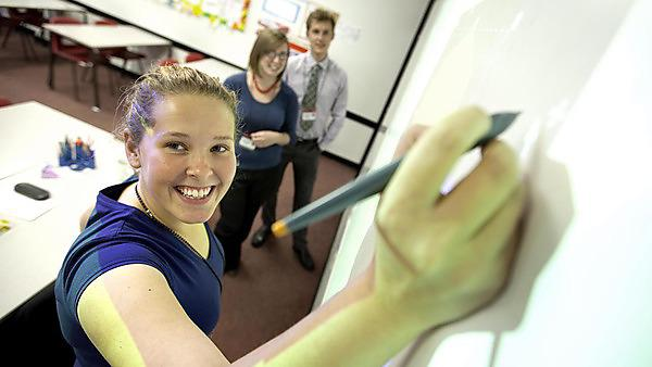 Students will be working on interactive whiteboards with teachers and pupils.