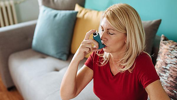 <p>woman inhaling asthmatic cure at home. Woman is living life with chronic illness everyday and overcoming challenges with it.<br></p> Usage: Image courtesy of Getty images