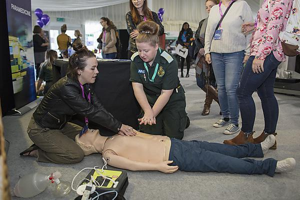 <p>Demonstrating CPR at the Health Showcase 2018</p>