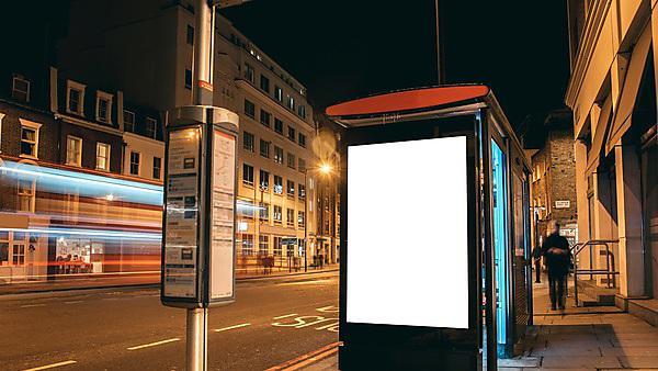 <p>A blank billboard at a bus station at night<br></p>