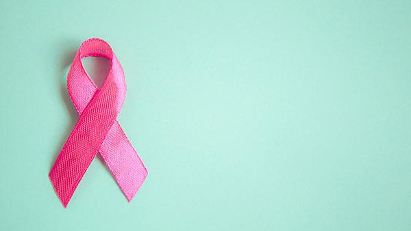 <p>pink ribbon breast cancer on a blue background.<br></p>