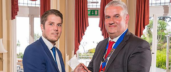 <p>Michael Wilcox receiving his award from Jon Benton, Chairman of CECA (SW)<br></p>