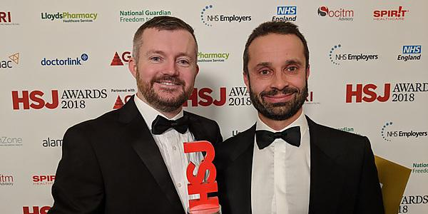 <p>Craign Newman and Rupert Noad HSJ award ACEMobile</p>
