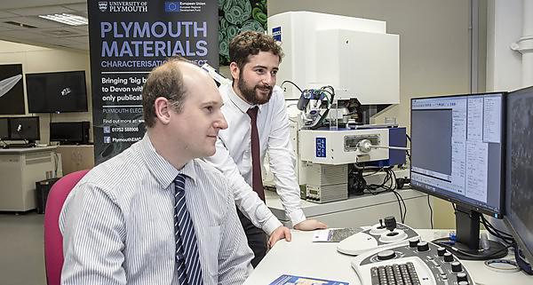 James Bradbury (left) with Dr Dan Haspel operating the new FIB-SEM