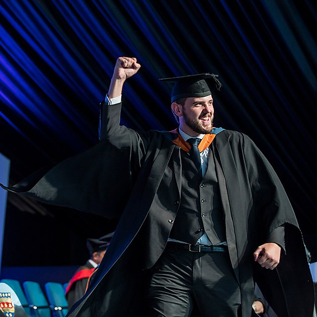 <p>Graduation fist pump</p>