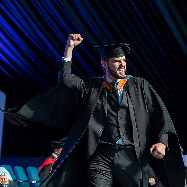 <p>Graduation fist pump</p>