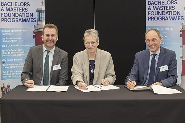 <p>The signing of the agreement, with Vice-Chancellor Professor Judith Petts, CBE, centre.</p>