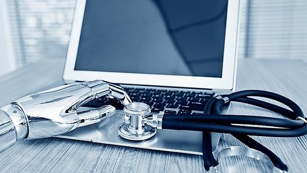 <p>Robot's hand holding stethoscope on a keyboard<br></p>