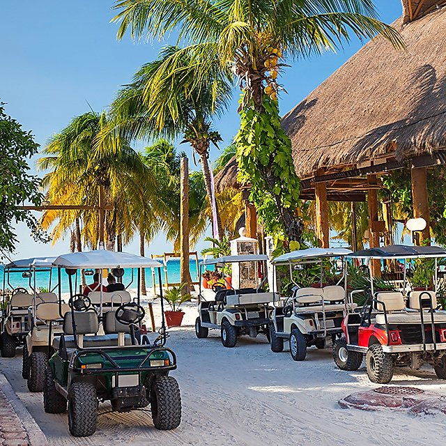 <p>Buggies parked by the beach in Isla Mujeres, Mexico.<br></p>